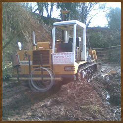 Tracked machine in deep mud, no conditions too wet!