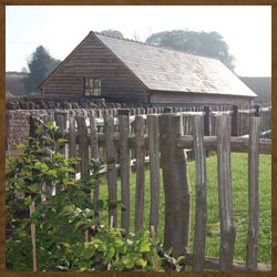Wooden fencing around a horse stable